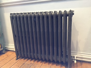 Photo of a radiator in an old building